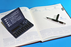 Financial tools, agenda, pen and calculator Stock Image