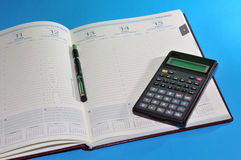 Financial tools, agenda, pen and calculator. Various financial tools. Concept: End of year financial closure Royalty Free Stock Photography