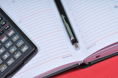 Financial tools, agenda, pen and calculator. Various financial tools. Concept: End of year financial closure Stock Image