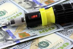 Financial Tools US Currency with Screwdriver Royalty Free Stock Photography