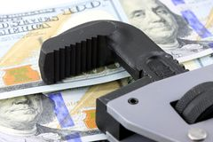 Financial Tools US Currency with Wrench Royalty Free Stock Photos
