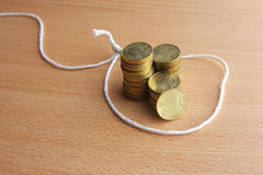Financial trap - Coins within a trap - Series 2 Royalty Free Stock Photo