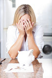 Financial trouble. Unhappy young woman having financial trouble Stock Photos