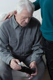 Financial troubles. Picture of retired men having financial troubles stock photos