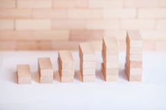 Financial wood graph. Small business building with small wood cube Royalty Free Stock Images