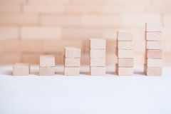 Financial wood graph. Small business building with small wood cube Stock Photo