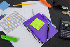 Financial workers desk showing a spreadsheet and graphs Stock Photography