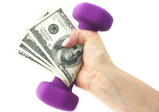Financially Fit. Fiscally fit—holding cash with dumbbells on a white background Stock Image