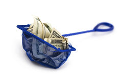 Financially Trapped. Money trapped by a fishing net. Selective focus stock images