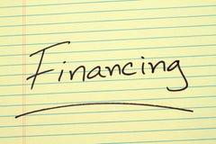 Financiamiento en un cojín legal amarillo imágenes de archivo libres de regalías