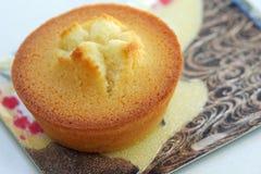 Financier cake. Close up shot of golden financier cake on pretty plate stock image