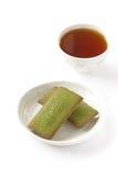 Financier cake. Maccha green tea financier cake and cup of tea stock photo