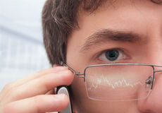 Financier in glasses looking at monitor. Royalty Free Stock Photo