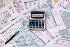 Filling in the tax form. Financing concept - filling in the tax form Royalty Free Stock Photo