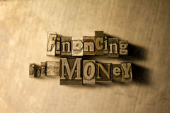 Financing for money - letterpress text sign. Lead metal  typography text on wooden background Stock Photography