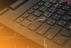 Finane data on keyboard computer and graph business concept Royalty Free Stock Image