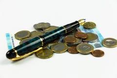 Finans, euromynt, penna och miniräknare på vit bakgrund Royaltyfria Foton