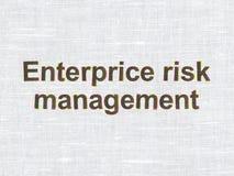 Finansbegrepp: Enterprice riskledning på tygtexturbakgrund Arkivfoto