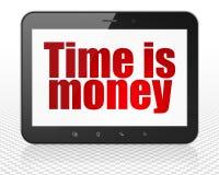 Finansbegrepp: MinnestavlaPCdatoren med Tid är pengar på skärm Arkivfoto