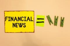 Finansiell nyheterna för ordhandstiltext Affärsidé för bankverksamhet inom huvudsakligen värdepappershandelmedelsförvaltningregle royaltyfria foton