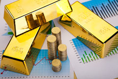 Finansiella indikatorer, diagram, guld- stång Royaltyfri Bild