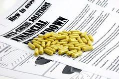 finansiella isolerade pills för artikelkris Royaltyfria Bilder