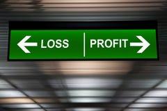 finansiellt begrepp Förlust- och vinstpilar undertecknar, den indikerade aktiemarknaden Royaltyfria Foton