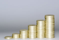 Finantial success. Piles of coins Royalty Free Stock Photo