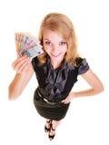 Finanzas de la economía La mujer sostiene el dinero euro de la moneda Fotografía de archivo