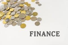Finanzas de la palabra con las monedas de Malasia fotos de archivo libres de regalías