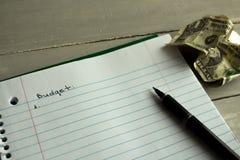 Finanzas del presupuesto del dólar de la pluma del cuaderno Fotografía de archivo