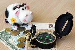 Finanzberatung - Kompass, zum sich während der Zukunft durch accu zu interessieren Stockbild