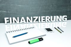 Finanzierung text concept. Finanzierung - german word for funding or financing - text concept with chalkboard, notebook, pens and mobile phone. 3D render Stock Photos