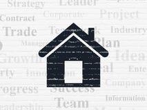Finanzkonzept: Haus auf Wandhintergrund Stockbild