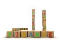 Finanzkonzept - Spiel-Bausteine des Kindes Lizenzfreie Stockbilder
