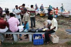 Finanzregelung nach einem Fischereitag Lizenzfreie Stockbilder