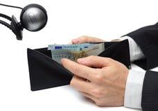 Finanzspionagekonzept mit Geldbörse und Kamera Lizenzfreie Stockfotos
