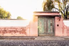Finca port wth sunbeam in colonial style in Antigua, Guatemala. Finca port in colonial style with rose wall and sunbeam in Antigua, Guatemala royalty free stock photos