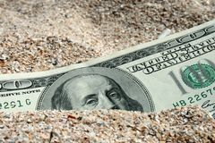 Find. One hundred dollars in sand on a beach Stock Photos