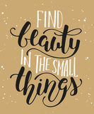 Find beauty in the small things, modern calligraphy with splash. Royalty Free Stock Photos