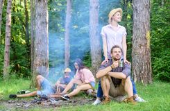 Find companion to travel and hike. Company friends couples or families enjoy relaxing together forest. Awesome hiking. Great company. Friends relaxing near royalty free stock images