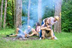 Find companion to travel and hike. Company friends couples or families enjoy relaxing together forest. Friends relaxing. Near campfire after day hiking or stock images