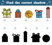 Find the correct shadow for children. Christmas gifts. Find the correct shadow, education game for children. Vector set of Christmas gifts Royalty Free Stock Photos