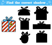 Find the correct shadow. Christmas gifts. Find the correct shadow, education game for children. Christmas gifts Royalty Free Stock Images