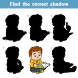Find the correct shadow, game for children, Young boy reading a. Find the correct shadow, education game for children, Young boy reading a book Stock Photos