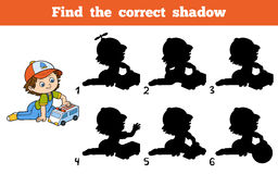 Find the correct shadow. Little boy plays with ambulance car. Find the correct shadow, education game. Little boy plays with ambulance car Royalty Free Stock Image