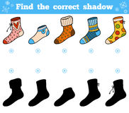 Find the correct shadow, set of socks with ornaments. Find the correct shadow, education game for children, set of socks with ornaments Stock Photos