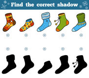 Find the correct shadow, set of socks with ornaments. Find the correct shadow, education game for children, set of socks with ornaments Royalty Free Stock Images