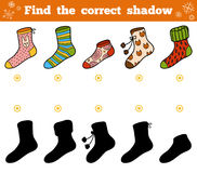 Find the correct shadow, set of socks with ornaments. Find the correct shadow, education game for children, set of socks with ornaments Royalty Free Stock Photo