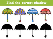 Find the correct shadow, set of umbrellas. Find the correct shadow, education game for children. Vector set of umbrellas Stock Photo